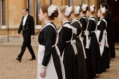 Image from Downton Abbey Season 1: Female servanst line up to greet visitors © Carnival Film & Television Limited 2010 for MASTERPIECE