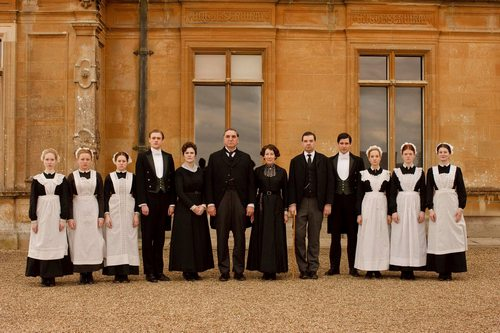 Image from Downton Abbey Season 1:: servants in front of Downton Abbey © Carnival Film & Television Limited 2010 for MASTERPIECE