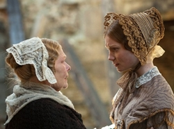 Mrs. Fairfax (Judi Dench) and Jane Eyre (Mia Wasikowska ) in Jane Eyre (2011)