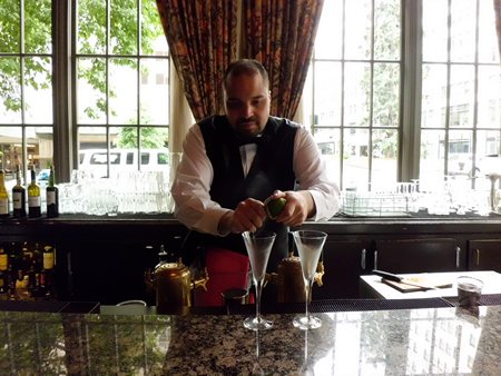 Bartender at Oliver's in the Mayflower Park Hotel preparing our Downton Abbey martinis