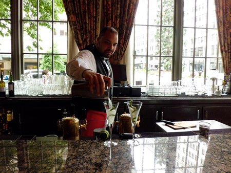 Bartender at Oliver's at the Mayflower Park Hotel preparing Downton Abbey martini's 2