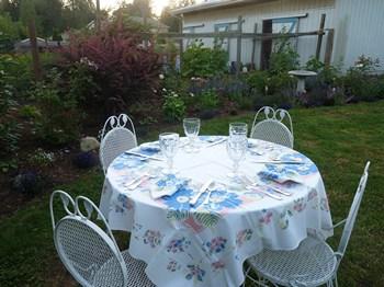 The table setting for dinner in Woodston Cottage garden (2012)