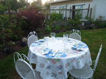The table setting for dinner in Woodston Cottage garden (2012)