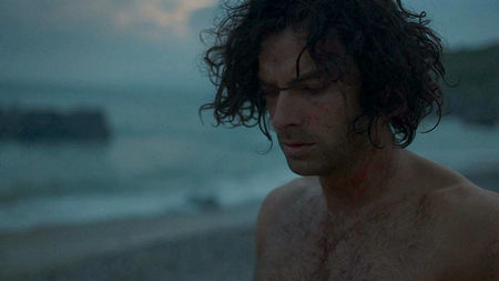 Ross (Aidan Turner) burns his shirt. Image (c) 2015 Mammoth Screen, Ltd. for Masterpiece PBS