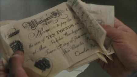 Image of ten pound draft drawn on Warleggans Bank. (c) 2015 Mammoth Screen, Ltd for Masterpiece PBS